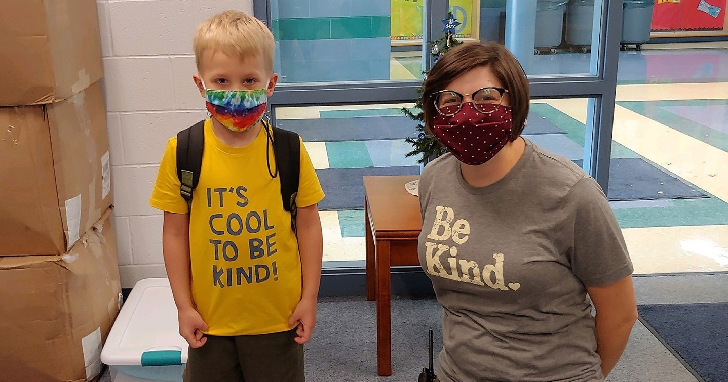 """Student and teacher wearing """"Be Kind"""" tshirts"""