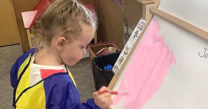 Preschool girl painting