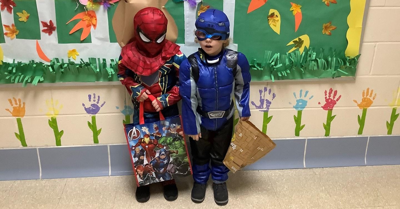 Two preschool students in Halloween costumes