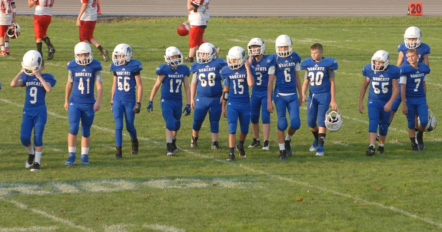 Middle School Football Players walking off field in line