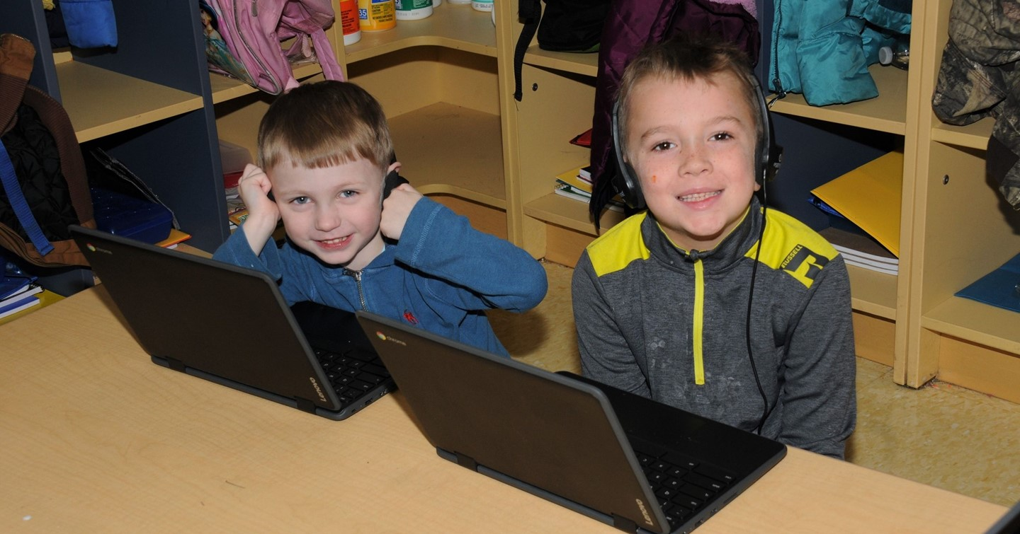 Two Primary School students on lap tops