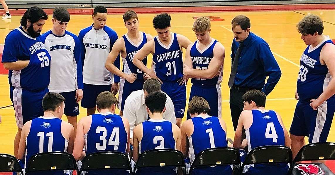 Boys basketball team in huddle during timeout