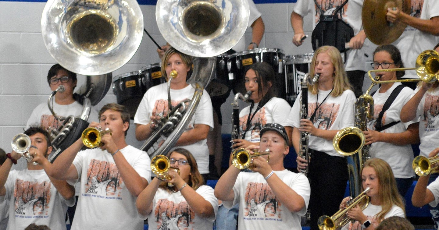 Pep band playing in gym bleachers