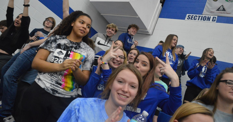 Middle School kids in gym bleachers cheering