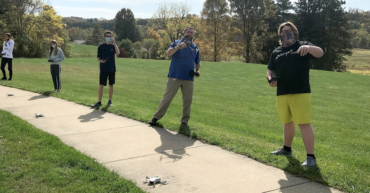 Drone Class Students receive mission instructions from Mr. Hannon