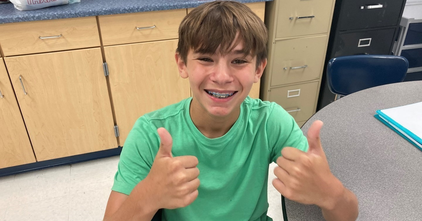 CMS Student give a thumbs up