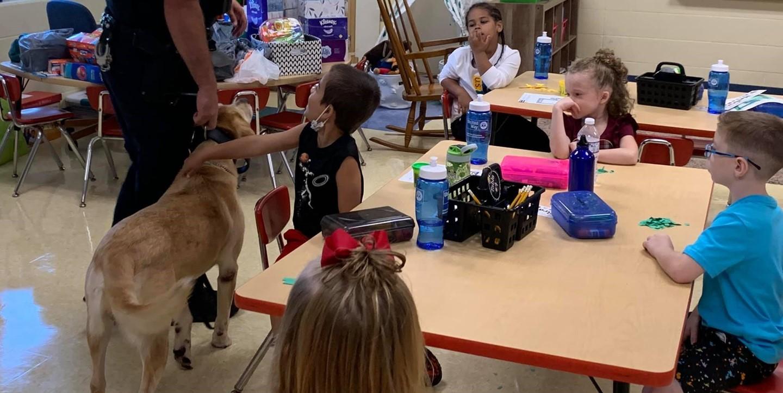 Jota the K9 visits students